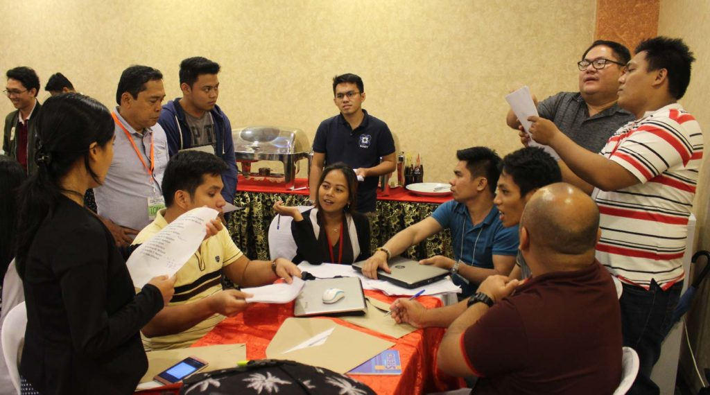 Group 2 members with Engr. Lim discussing the data they collected from the company visit