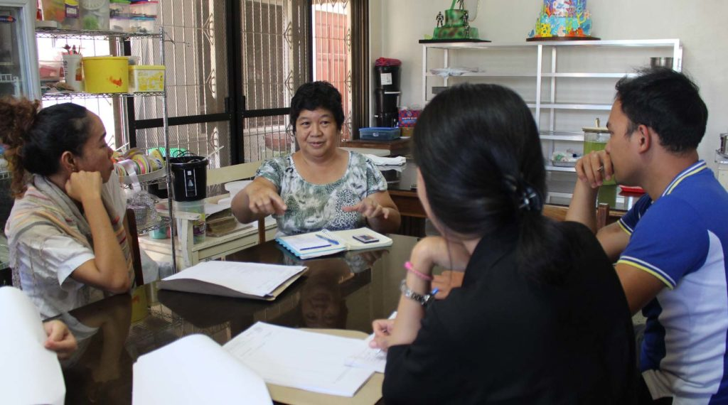 Group 1 members interviewing Mrs. Flora Martirez, the proprietor of Flora's Cakes and Pastries in Buenavista, Agusan del Norte