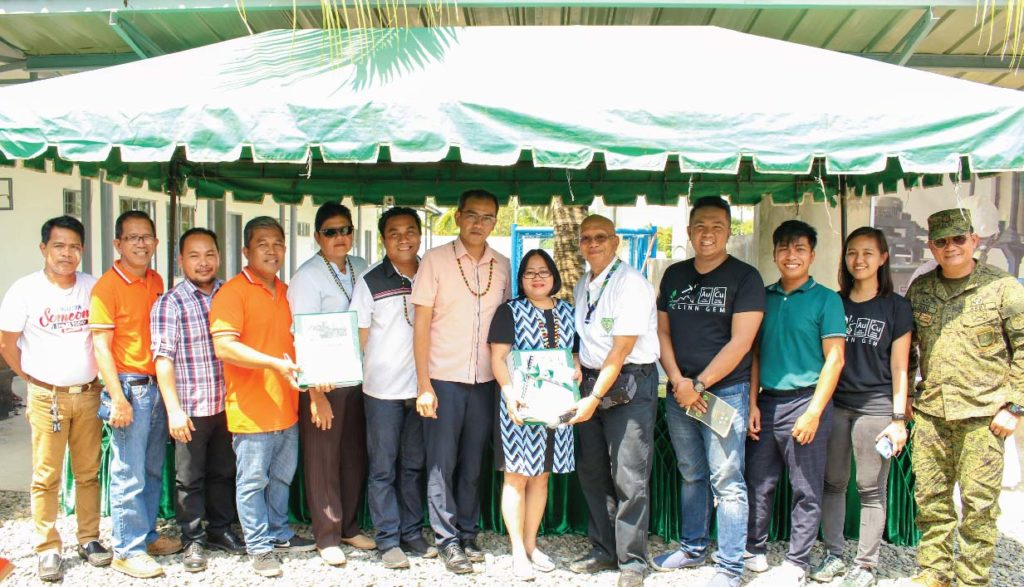 DOST-Caraga RD Dominga Mallonga (center) accepts the project's Standard Operating Procedures (SOP) and terminal report from Project Leader Dr. Herman Mendoza (center) and team (Left to right: Jun Endozo, Executive Asst. of the Governor, Ricardo N. Varela, DOST-Caraga Asst. RD for Field Operations, Dr. Rey Capangpangan, CSU Professor, Engr. Noel Ajoc, DOST-Caraga Technical Support Services Div. Chief, Hon. Arcrecia D. Camarin, Brgy. Del Pilar Captain, Hon. Dick Victor Carmona, Sangguniang Panlalawigan Member, Dir. Enrico Paringit, DOST-PCIEERD Executive Director, Engr. Noel Villavicencio, Engr. Louie Bedes, Engr. Anne Marie Reyes from UP, and Lt. Col. Isagani Criste, 29IB)